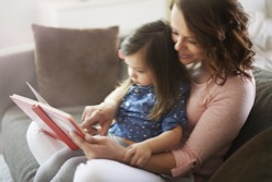 Research shows that reading aloud to children for 15 minutes daily helps to increase their vocabularies and develop a love of reading.
